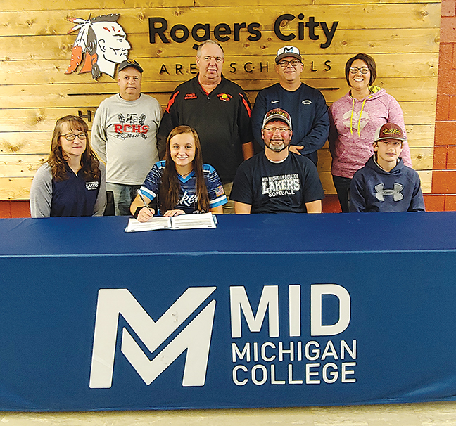 News Photo by James Andersen Rogers City senior Kyrsten Altman signed her letter of intent to play softball with Mid Michigan College in front of friends and family at Rogers City High School on Friday. Pictured left to right are, back: Gary Bisson, Rogers City softball coach Karl Grambau, Mid Michigan softball coach Bob Robinson and Christin Sobeck; front: Kathy Altman, Kyrsten Altman, Tim Altman and Josh Altman.