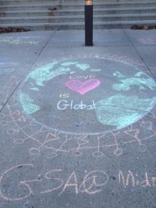 Love is Global is written in chalk on the Pickard campus sidewalks.