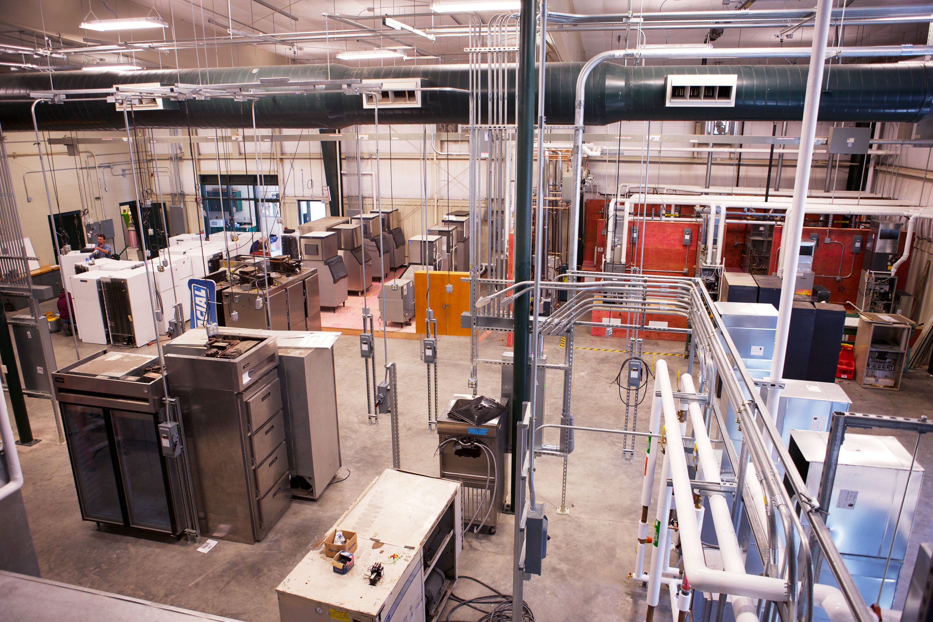 An bird's eye view of a geothermal system, as well as multiple ice machines, refrigerators, and overhead heating and cooling units.