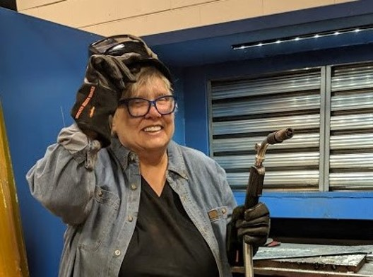 Sue Bergeson enjoys artistic welding at Mid.