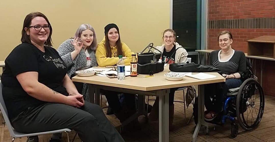 Members and officers of the club around a table at the De-stress event