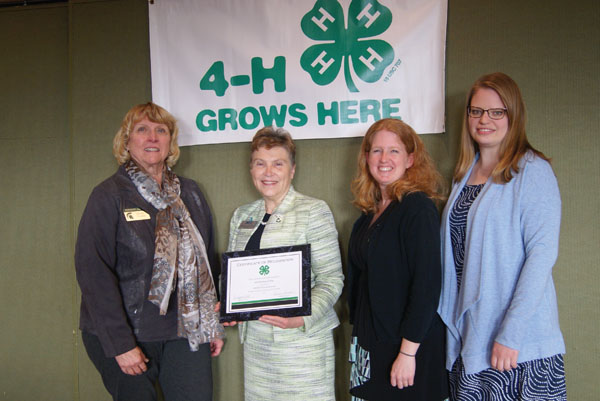 Dr. Christine Hammond, President of Mid Michigan College, received the Partnership Award at the annual MAE4-HYS Banquet. Pictured left to right: Bev Przystas, MSU Extension Educator, Dr. Christine Hammond, President of Mid Michigan College, Michelle Neff, MSU Extension Educator, Alex Schunk, Clare County 4-H Program Coordinator.