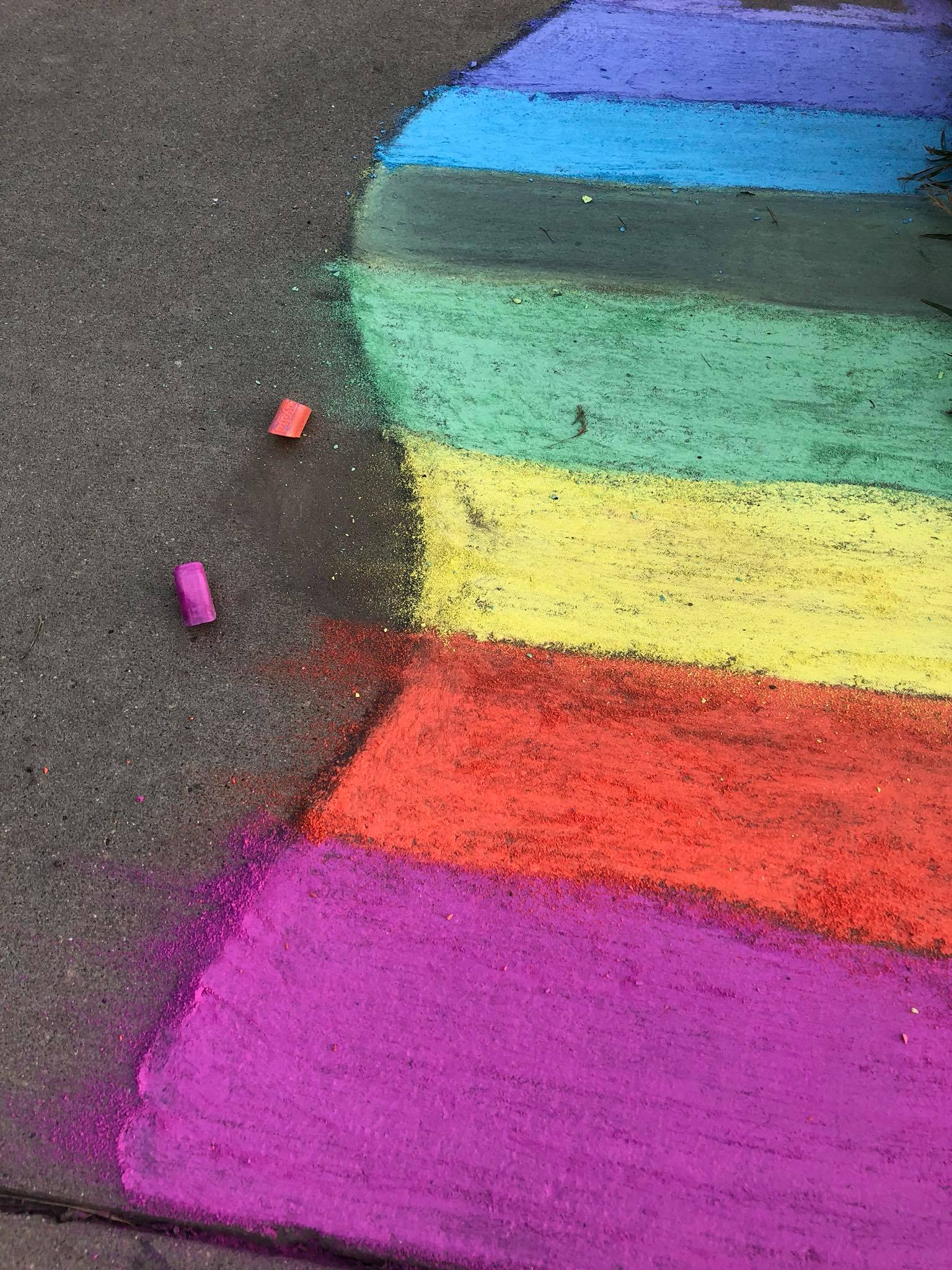 On the Mount Pleasant campus sidewalk, a rainbow is chalked vibrantly