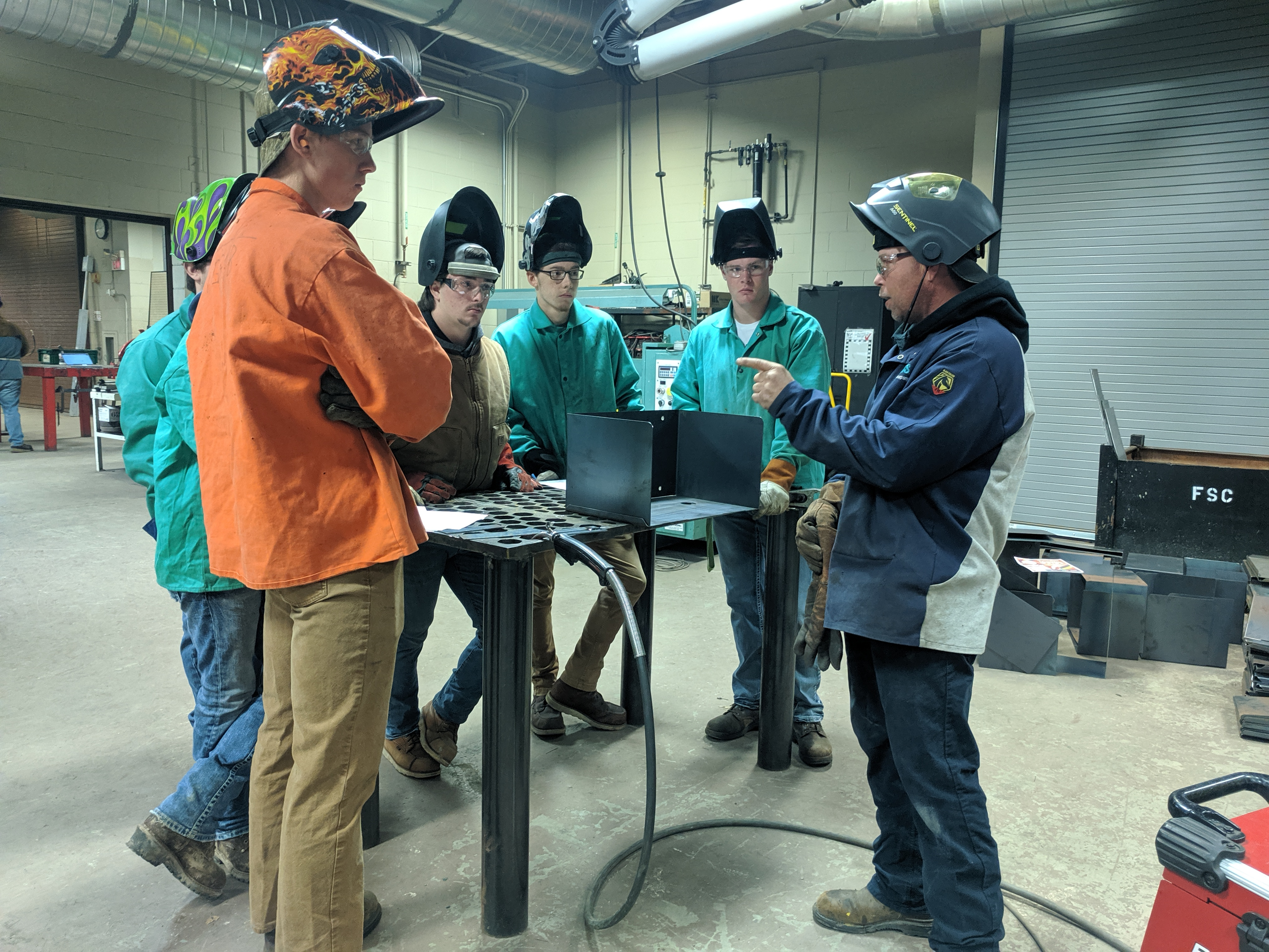 Welding students learn from industry-expert.