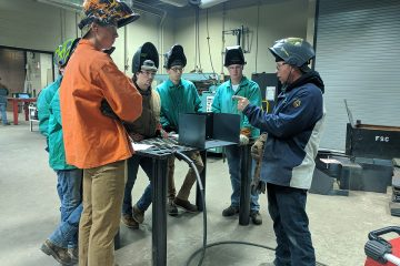 Welding students learn from an industry expert.