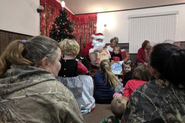 Children listen intently to a holiday story.
