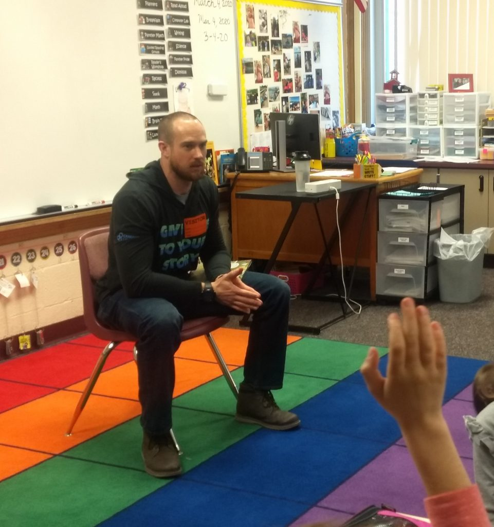 Chris Holton, Central Michigan Youth for Christ, read to Hillcrest elementary students about healthy habits and talked to them about his role as a Health and Fitness Coordinator.