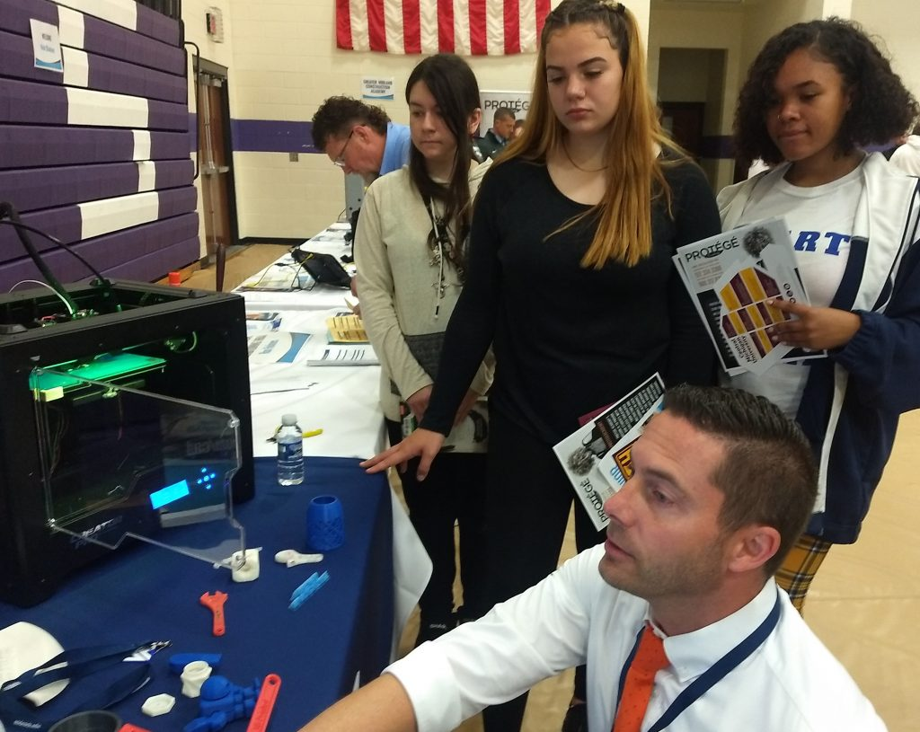 Eric Sander Sharing 3D printer with students.