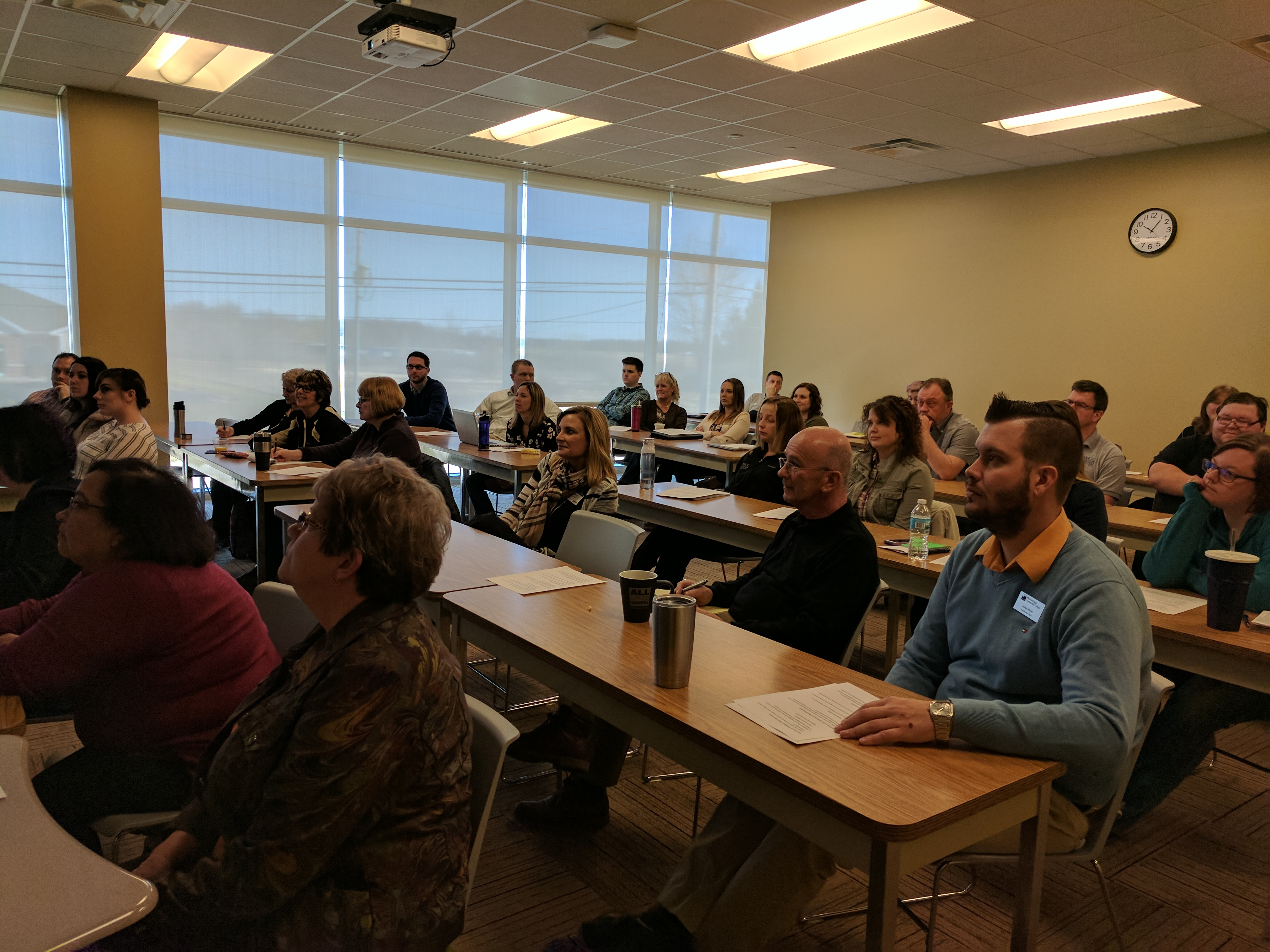 Classroom filled with employees and faculty during a professional development session