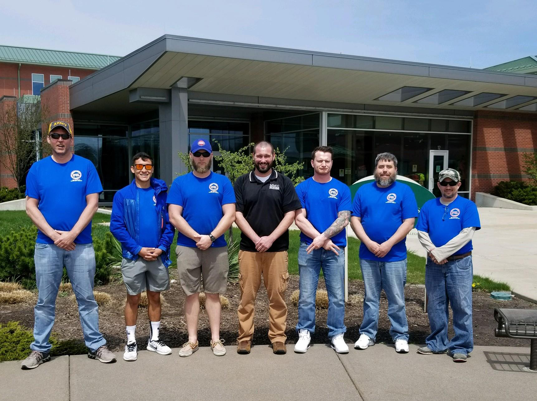 Members of the Student Veterans of America gather out front of the Mount Pleasant campus of Mid Michigan College.