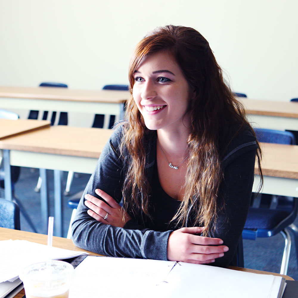 Student listens in class on the Harrison campus