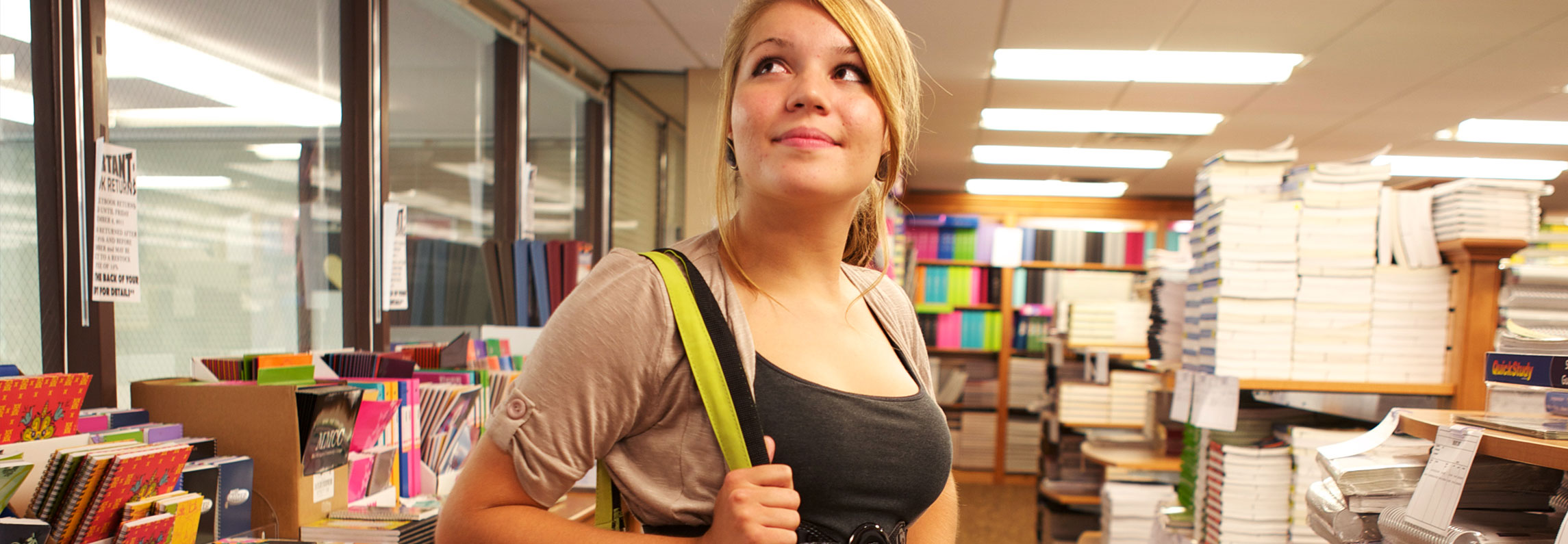 Girl looking optimistically around the bookstore
