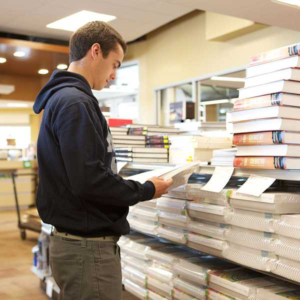 Student browses the Mount Pleasant campus bookstore